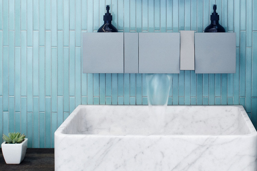 The Sen wall-mounted tap with 140 mm shelves in the grey finish, with the Agape Cararra basin and INAX Arcaico Border tiles.