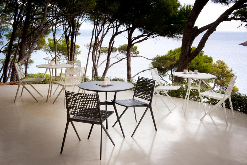 Branch side chairs and round bistro tables by Tribu.